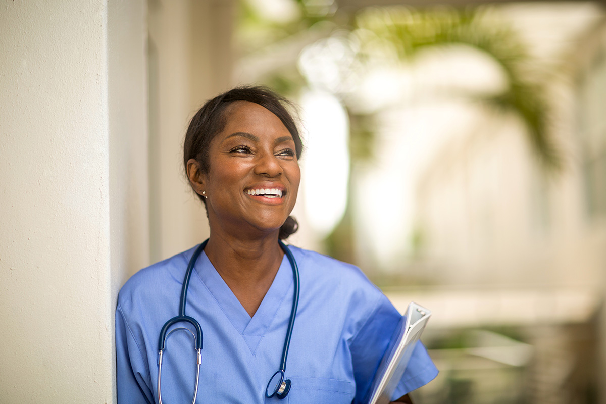 A woman working as a health care provider.